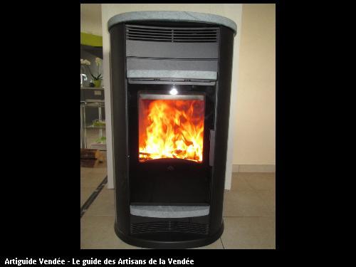poele bois pierre ollaire + ventilation de l air chaud par des bouches partie nuit sur les communes de jard sur mer et lairoux