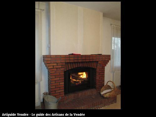 pose d un insert bois dans une cheminée existante  commune de Puyravault
