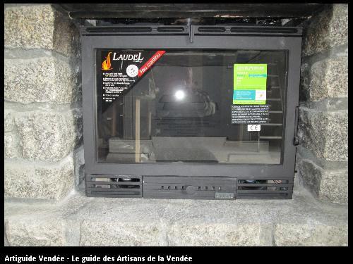 insert bois tout fonte dans une cheminée avec distribution d air chaud dans d autre pieces