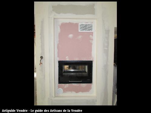 insert bois double face avec distribution d air chaud pour les chambres ,1 face salle a manger,1 face salon, commune de Mareuil sur Lay