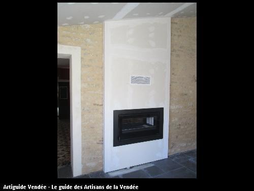 insert bois double face poser dans le mur 1 face donnant sur la cuisine et l autre face donne dans la salle a manger commune de st benoit sur mer