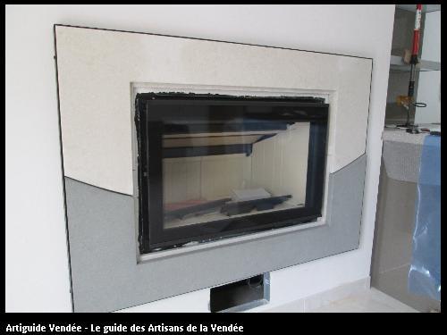 insert bois avec distribution d air chaud cadre pierre commune de chasnais