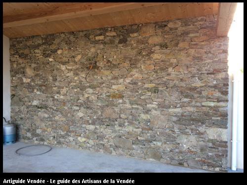Création mur de pierres sous auvent