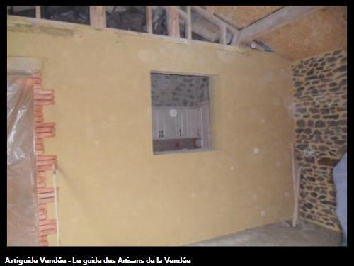 Extension en pierre apparente et ouverture brique
