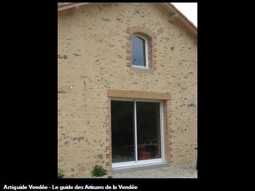 Percement d'ouvertures dans murs de pierres